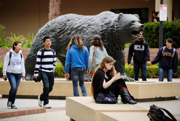 Students sit around the Bruin Bear statue during lunchtime on the campus of UCLA on April 23, 2012 in Los Angeles, California.