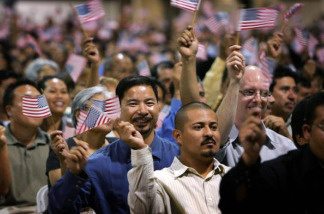 Immigrants wave flags during naturalization ceremonies on July 26, 2007 in Pomona, California. The state's cultural diversity has an influence on how its residents speak English.