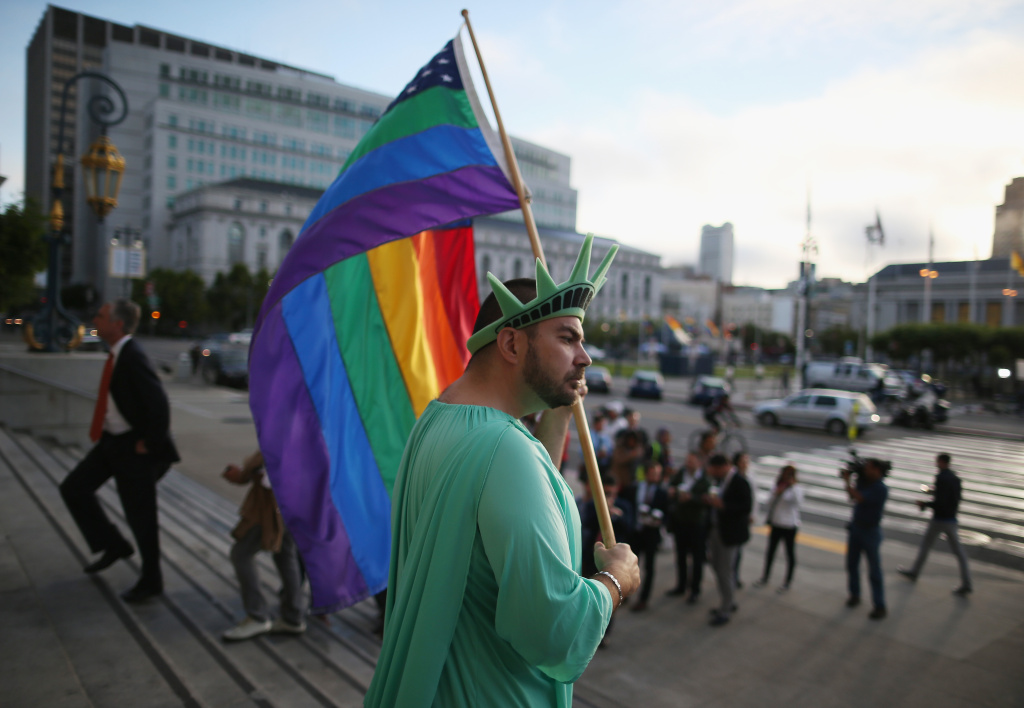 File photo: A gay rights supporter waves a flag at City Hall June 26, 2013 in San Francisco.