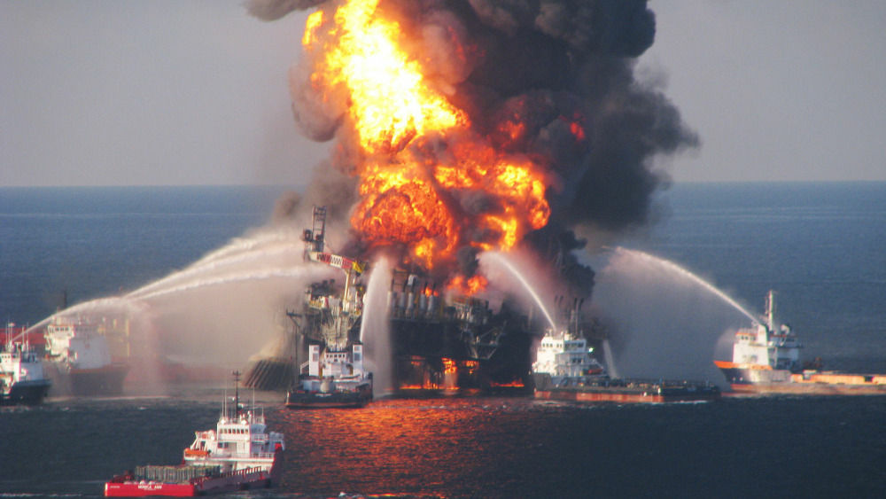 Justice Department prosecutors secured new indictments Wednesday against a former BP engineer and a former BP executive charged separately with obstructing probes of the company's 2010 oil spill in the Gulf of Mexico. (Photo: The Deepwater Horizon oil rig burned on April 21, 2010).