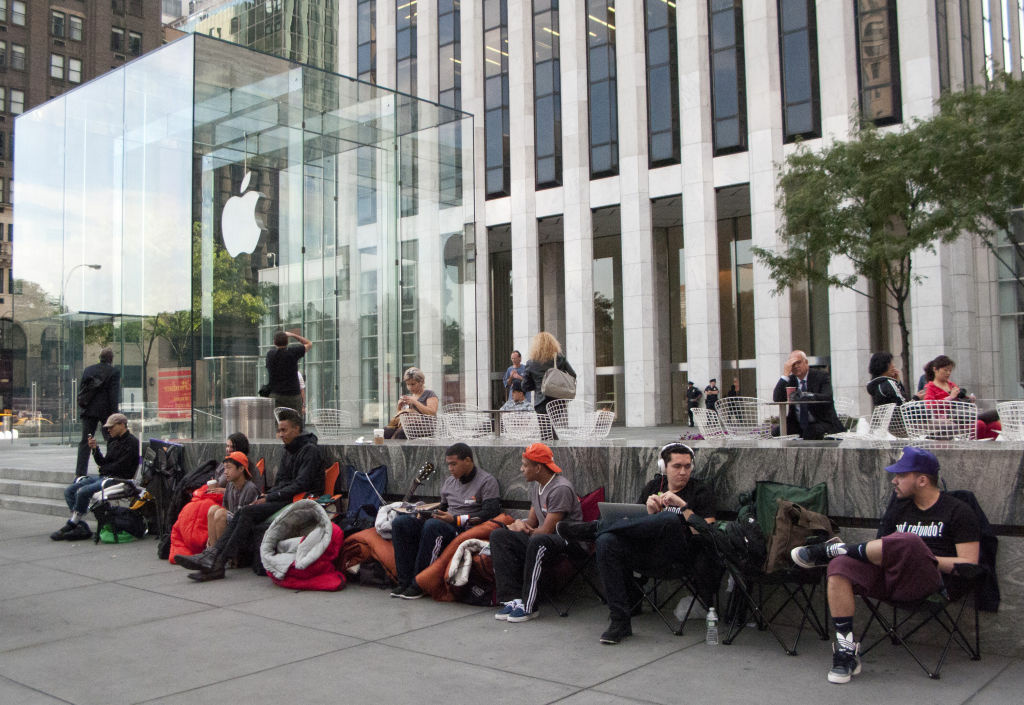 Buyers wait outside an Apple Store in New York to get their iPhone 5s before everyone else. The new smartphone notched 2 million in pre-orders in its first 24 hours.