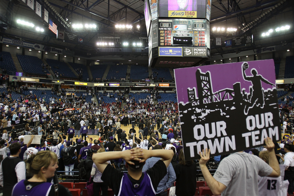 Fans of the Sacramento Kings hold up signs referencing the possible move to Anaheim in a game against the Los Angeles Lakers last year.