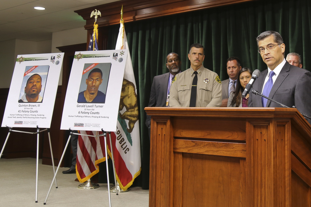 California Attorney General Xavier Becerra, far right, announces what authorities believe to be one of the largest human trafficking cases in the western United States during a news conference in in Los Angeles Thursday, July 27, 2017.
