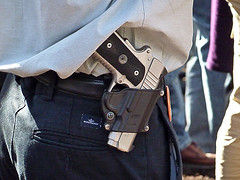 Is it jarring or reassuring to see guns in public?