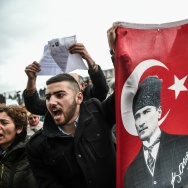 "Supporters of the ""No voters"" and members of Turkey's main opposition party, the Republican People's Party (CHP), hold a flag of Mustafa Kemal Ataturk."