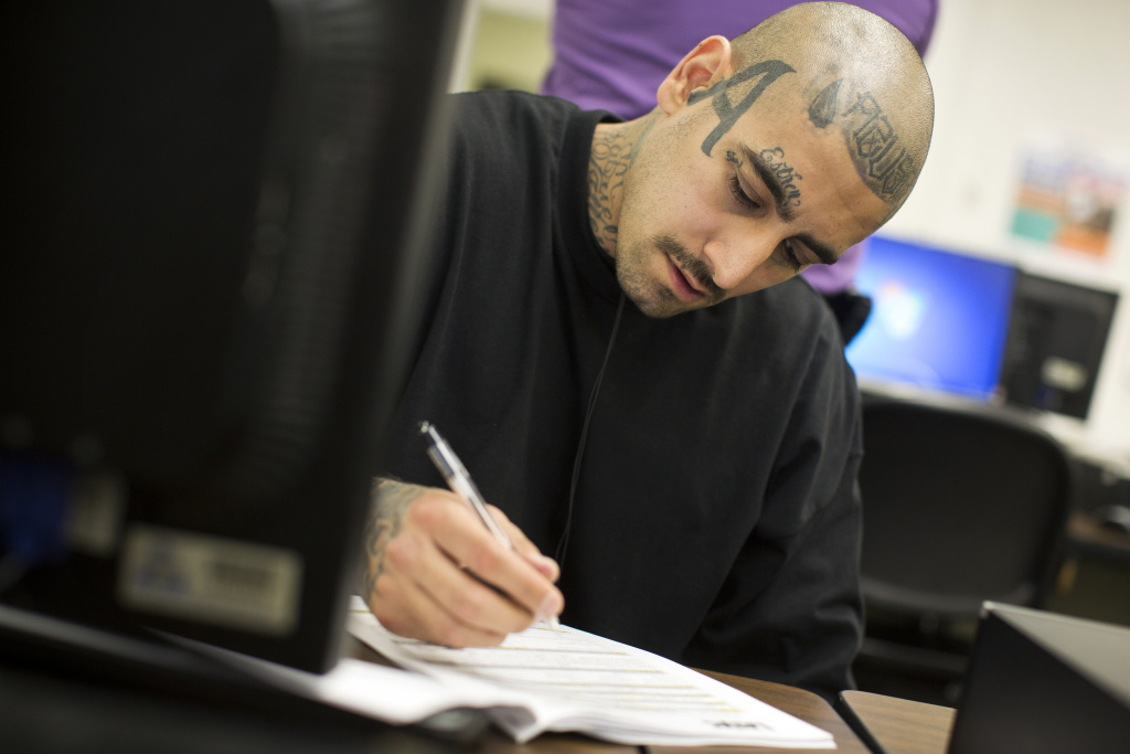David Williams, who works at Homeboy Industries, fills out paperwork to enroll in a seven-week construction course at Los Angeles Trade Tech College on Monday, April 1, 2015. Homeboy is one of the grantees in a $59 million federal investment announced Thursday.