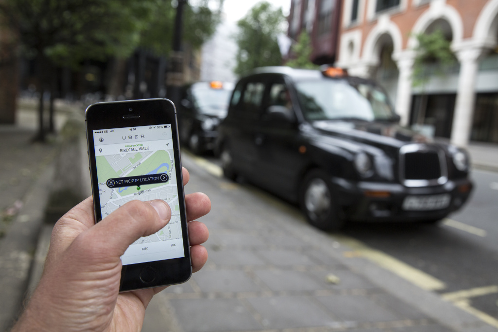 In this photo illustration, a smartphone displays the 'Uber' mobile application which allows users to hail private-hire cars from any location on June 2, 2014 in London, England.