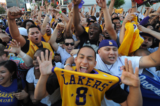 Los Angeles Lakers fans celebrate outside the Staples Center in Los Angeles after their team defeated the Orlando Magic in the NBA final on June 14, 2009. The Lakers won the series 4-1