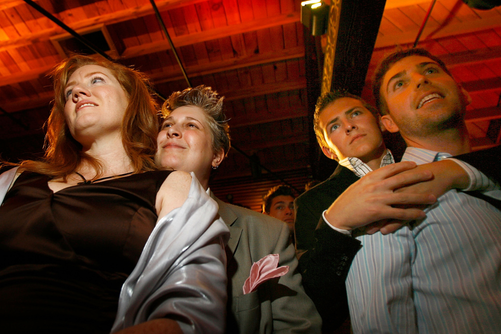Sonora Chase (L) and Dasha Snyder (2ed L), and Matthew Krumlick (2ed R) and Sawyer Snowden (R) participate in a symbolic group commitment ceremony for same-sex couples to kick off National Gay Pride Month at The Abbey bar and restaurant on June 4, 2008 in West Hollywood, California.