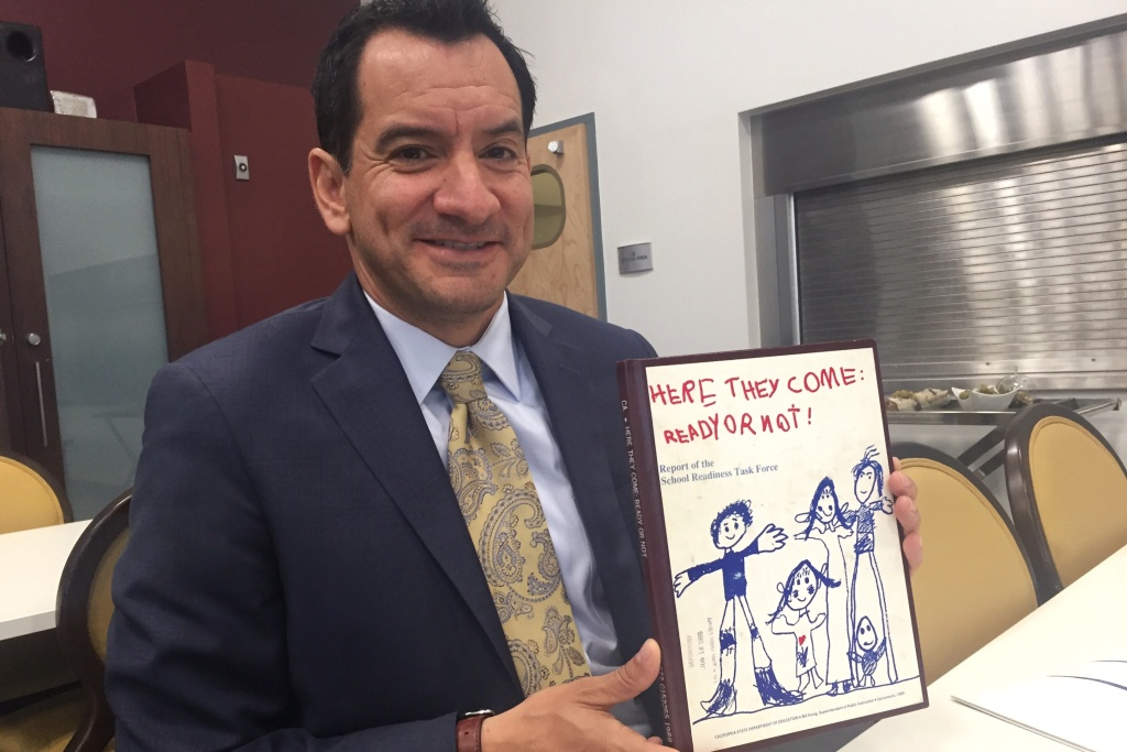 Speaker of the California State Assembly Anthony Rendon poses with a report on early childhood education released in 1988.