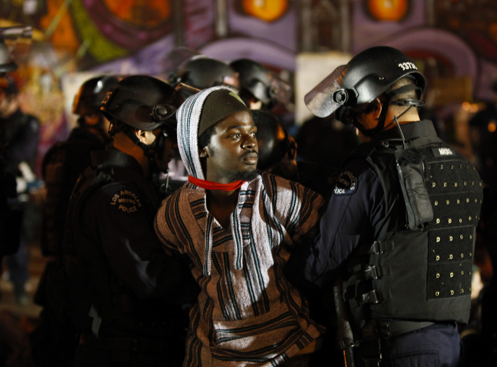 An Occupy Los Angeles protester is arrested by Los Angeles Police Department officers.