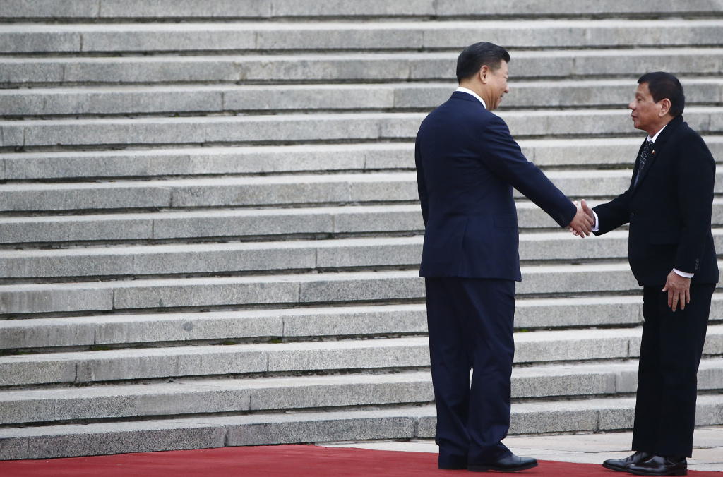 President of the Philippines Rodrigo Duterte and Chinese President Xi Jinping shake hands as they attend a welcoming ceremony at the Great Hall of the People on October 20, 2016 in Beijing, China.