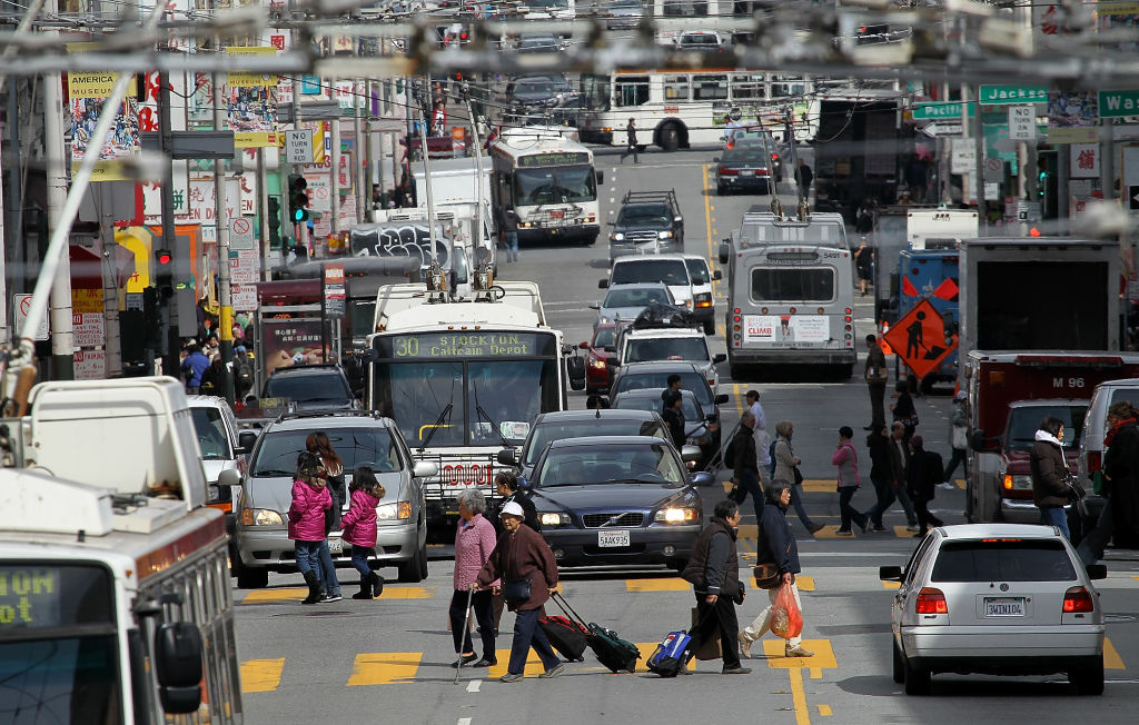 Cars and buses share the road along Stockton Street on March 26, 2012 in San Francisco, California. A Treasury Department report finds that Americans are wasting close to 1.9 billion gallons of gasoline each year sitting in traffic on congested roads. On the average, drivers are paying around $4 per gallon for gasoline.