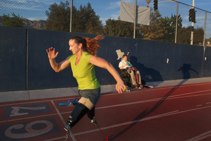 Katy Sullivan sprints past her husband Jay Cramer on the track at Burbank High School on August 15. The next day, she would fly to London to compete in the Paralympic Games.