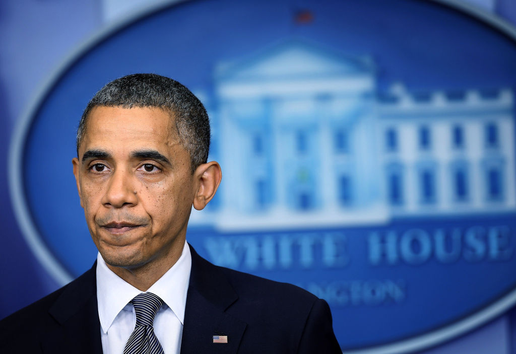 U.S. President Barack Obama pauses as he makes a statement in response to the elementary school shooting in Connecticut December 14, 2012 at the White House in Washington, DC. Later Sunday evening, Obama will speak at an interfaith vigil in Newtown, where the tragedy occurred.