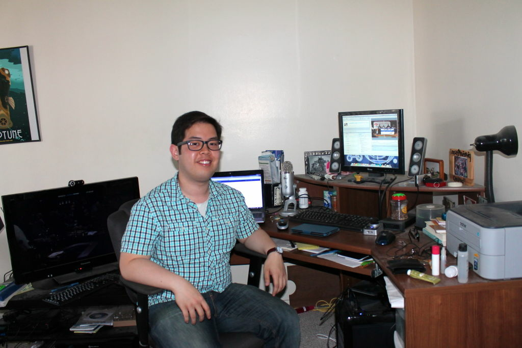 Quincy Surasmith surrounds his desk with five electronic screens at his apartment. He has a Mac desktop computer, a laptop, home theater PC, tablet and a smartphone. Networks are now marketing to people like Surasmith using social media and apps to create an interactive experience for viewers.