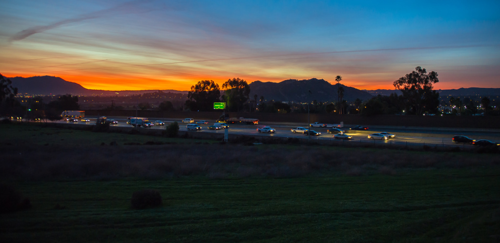 Sunrise over California Highway 60 in Jurupa Valley.