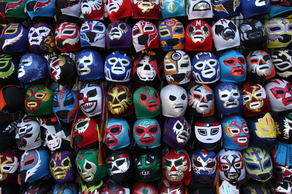 File: A wall of lucha libre masks at a store in San Francisco's Mission District.