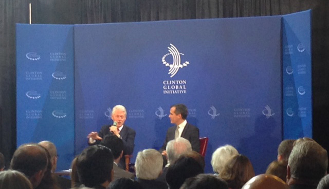 Former President Bill Clinton and Los Angeles Mayor Eric Garcetti discuss how cities can pay for infrastructure projects during an event for the Clinton Global Initiative at City Hall.
