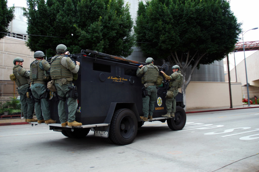 Officers from the Los Angeles County Sheriff's Department ride an armored police vehicle outside the Twin Towers Correctional Facility in Los Angeles on Feb. 8, 2013, following reports that murder suspect Christopher Dorner was seen in the area.