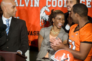Natalie Randolph is the center of attention at a news conference held by Washington, D.C., Mayor Adrian Fenty (left). She'll coach the Coolidge High Colts this fall.
