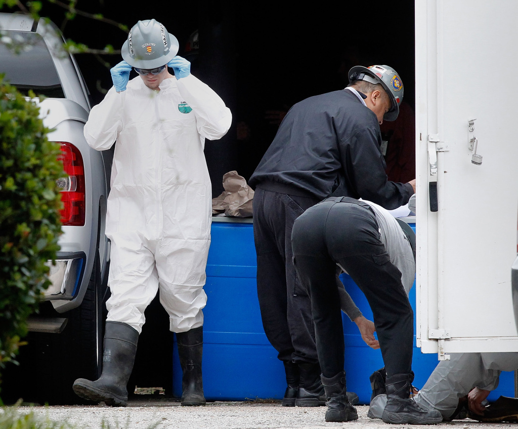 DALLAS, TX - OCTOBER 13:  A hazmat worker prepares to enter an apartment  where a second person diagnosed with the Ebola virus resides on October 13, 2014 in Dallas, Texas. Officials say a health care worker who cared for Liberian patient Thomas Eric Duncan has tested positive for the virus.  (Photo by Mike Stone/Getty Images)