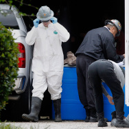 A hazmat worker prepares to enter an apartment  where a second person diagnosed with the Ebola virus resides on October 13, 2014 in Dallas, Texas. Meanwhile in politics, some have been invoking Ebola as as the latest border threat.