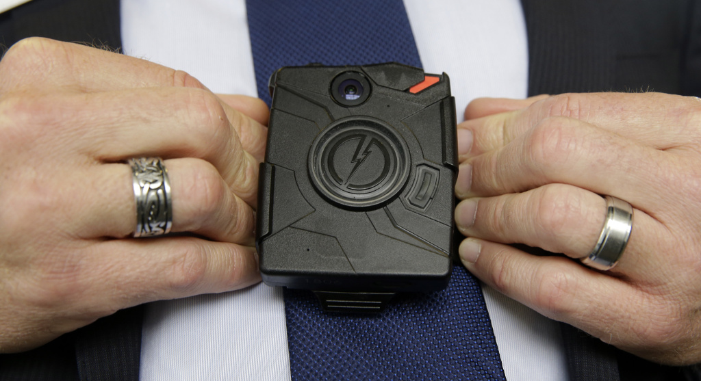 In this Feb. 19, 2015 file photo, Steve Tuttle, vice president of communications for Taser International, demonstrates one of the company's body cameras during a company-sponsored conference at the California Highway Patrol Headquarters in Sacramento. Sacramento police have issued a new directive on when officers can turn off body cameras. It comes after two officers muted their microphones minutes after fatally shooting Stephon Clark last month. The new memo, issued last week, was discussed at a Monday, April 9, 2018, police commission meeting.