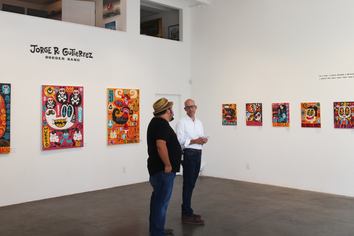 Artist Jorge Gutierrez, left, and The Frame host John Horn at the Gregorio Escalante Gallery in Chinatown, which is presenting Gutierrez's