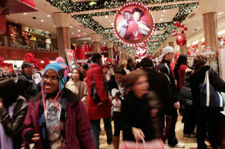 Shoppers move about in Macy's department store in Midtown Manhattan November 26, 2010 in New York City.