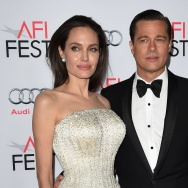 Writer-director-producer-actress Angelina Jolie Pitt (L) and actor-producer Brad Pitt arrive for the opening night gala premiere of Universal Pictures' 'By the Sea.'