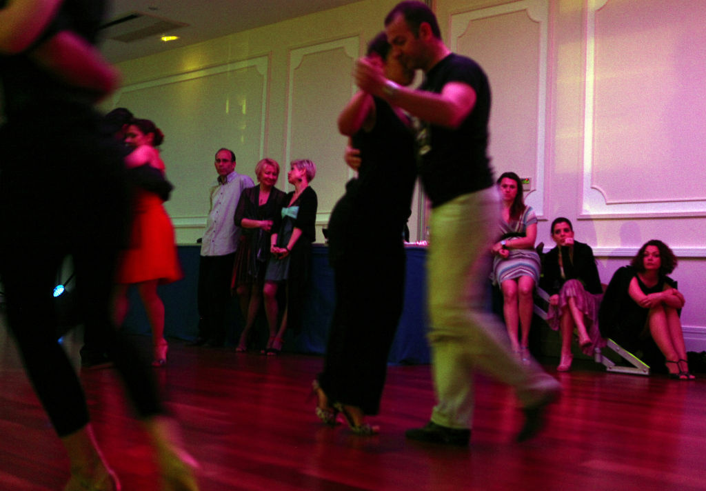 Couples perform a tango dance in the southeastern resort of Protaras late on March 31, 2012.