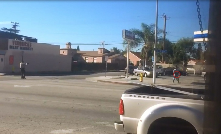 Photo from witness video provided to KTLA, which appears to show Los Angeles County Sheriff's deputies fatally shooting man in Lynwood on Dec. 12, 2015.