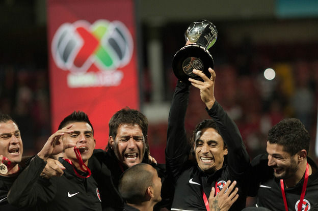 Tijuana players celebrate their victory over Toluca after their Mexican Apertura tournament final football match on Sunday. Several U.S. citizens play for the team.