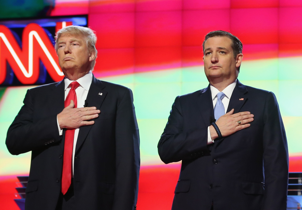 In this file photo, Republican presidential candidates Donald Trump and Sen. Ted Cruz (R-TX), listen to the national anthem before the start of the CNN, Salem Media Group, The Washington Times Republican Presidential Primary Debate on the campus of the University of Miami on March 10, 2016 in Coral Gables, Florida. A new Field Poll released Thursday found 39 percent of likely GOP voters in California back Trump, while 32 percent support Cruz.