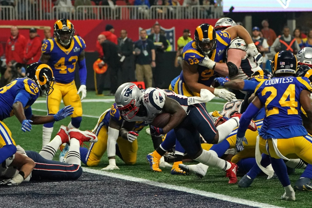 Running back for the New England Patriots Sony Michel scores a touchdown during Super Bowl LIII between the New England Patriots and the Los Angeles Rams at Mercedes-Benz Stadium in Atlanta, Georgia, on February 3, 2019