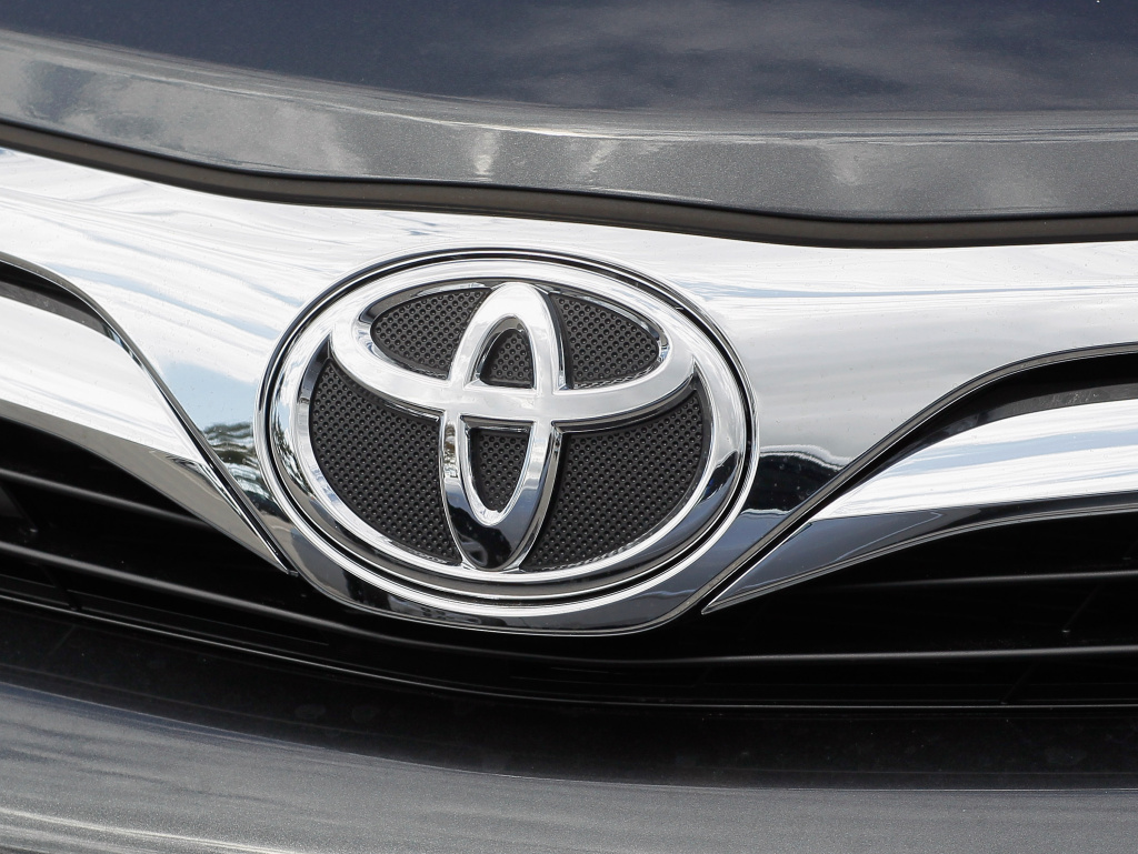 A Toyota emblem is seen on the front of a 2012 model year Camry automobile on a sales lot on November 9, 2011 in Miami, Florida.