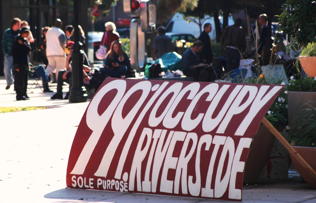Occupy Riverside protestors defy police orders, returning to the downtown plaza by City Hall one day after Riverside Police Department's raid.