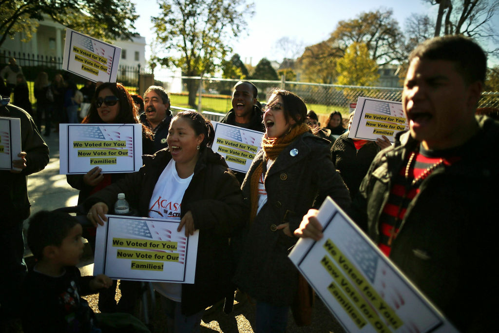 Latinos and immigrants participate in a rally on immigration reform in front of the White House on November 8, 2012 in Washington, DC.