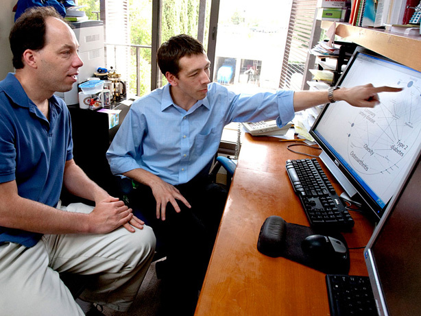 Stephen Quake (left) and Euan Ashley review genetic risk factors that Ashley and colleagues found in Quake's genome.