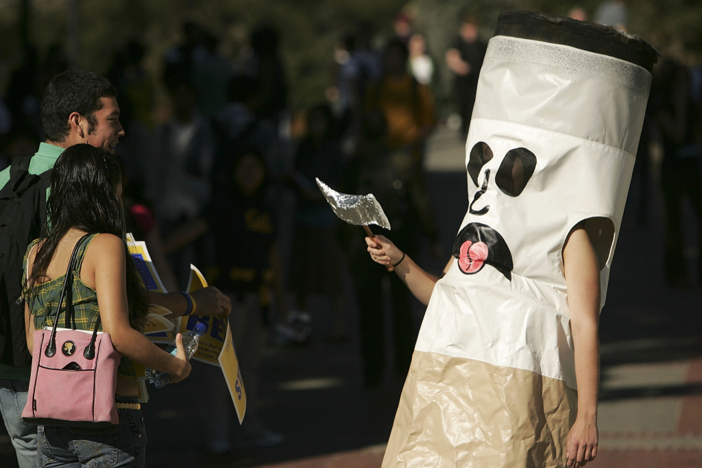 A person dressed as a cigarette called 'Ciggy Butts' encourages students on the UC Berkeley campus to quit smoking.