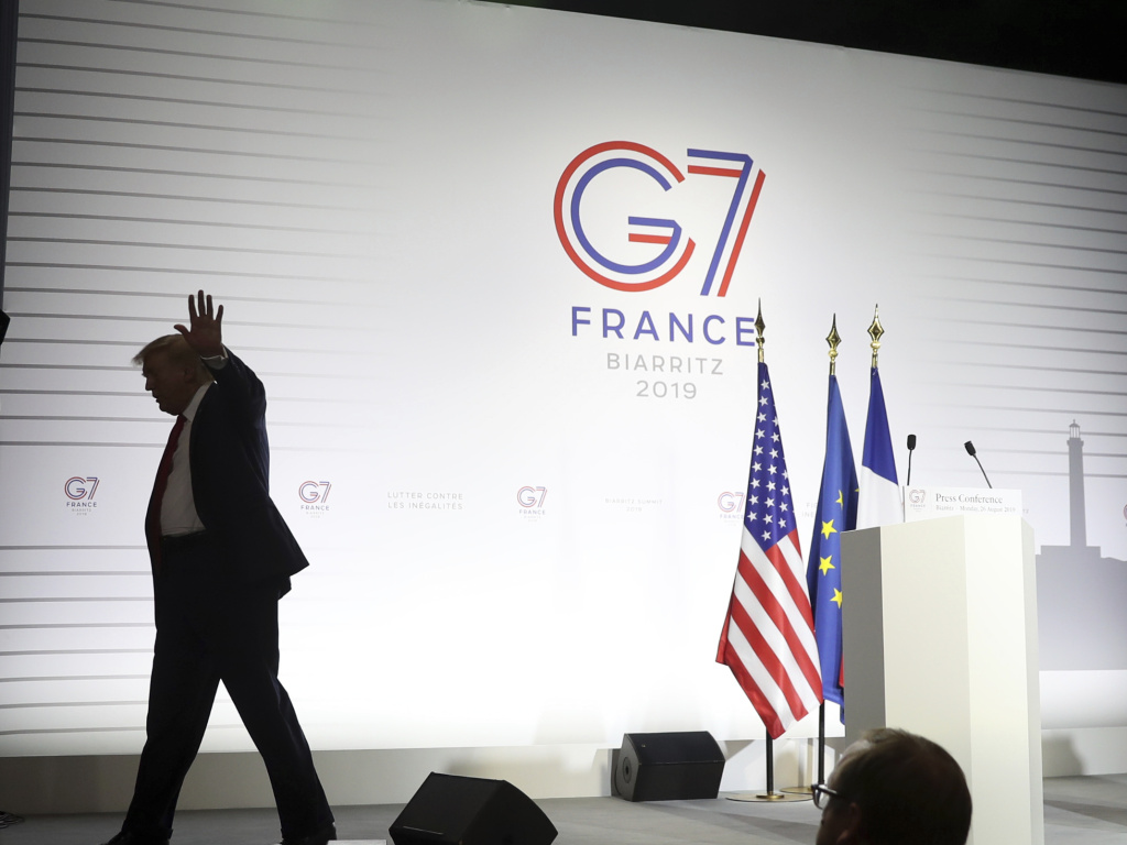 President Donald Trump walks off after taking additional questions following and a joint press conference with French President Emmanuel Macron at the G-7 summit in 2019.