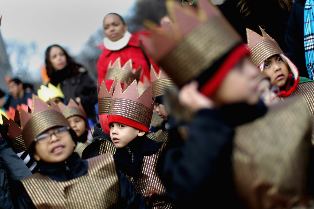 Children are dressed as kings in the Three Kings Day Parade in East Harlem on January 6, 2012 in New York City. The parade celebrates the Feast of the Epiphany, also known as Three Kings Day, marking the Biblical story of the visit of three kings to Bethlehem to visit the baby Jesus, revealing his divinity.