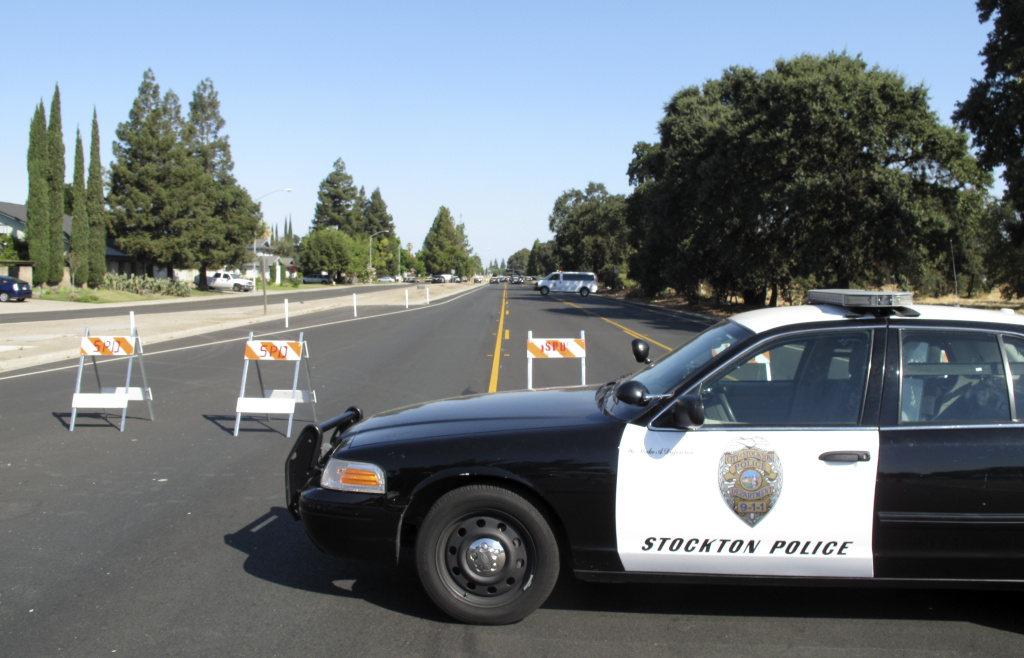 This Wednesday July 16, 2014 image provided by the Stockton Police Department shows the scene of a bank robbery in Stockton.