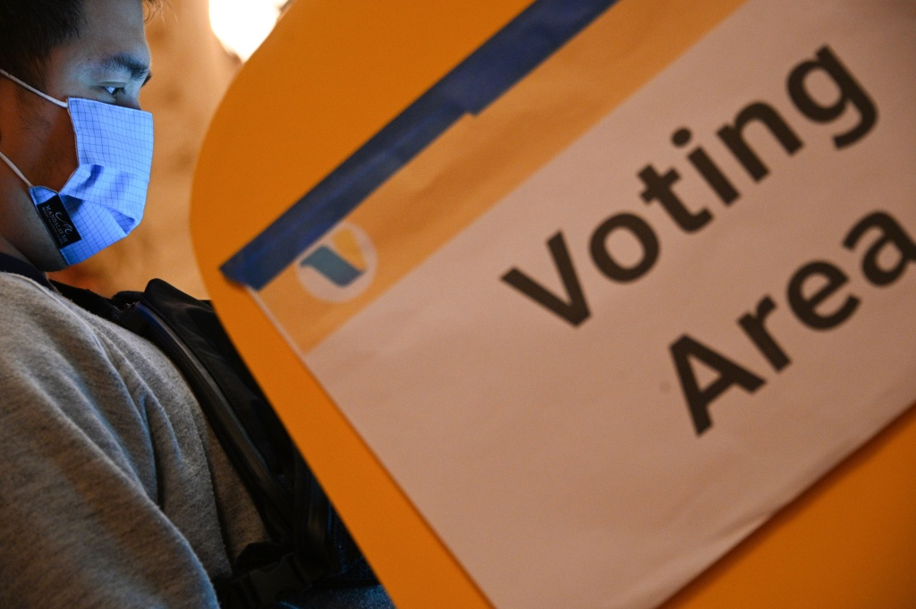 A voter casts his ballot at the Pantages Theatre polling station on November 3, 2020 in Los Angeles, California.