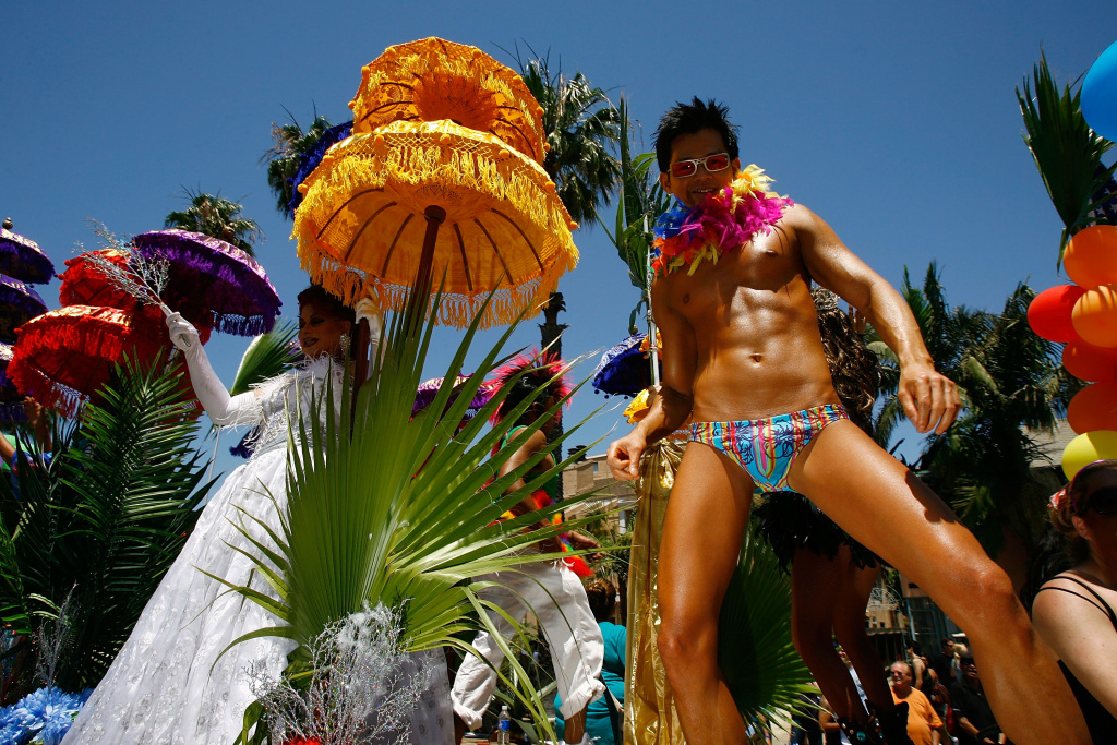 People participate in the 25th annual Long Beach Lesbian and Gay Pride Festival and Parade on May 18, 2008 in Long Beach, California.