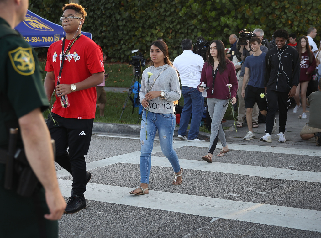 Students cross as they arrive to attend Marjory Stoneman Douglas High School for the first time since the shooting that killed 17 people on February 14  at the school on February 28, 2018 in Parkland, Florida.