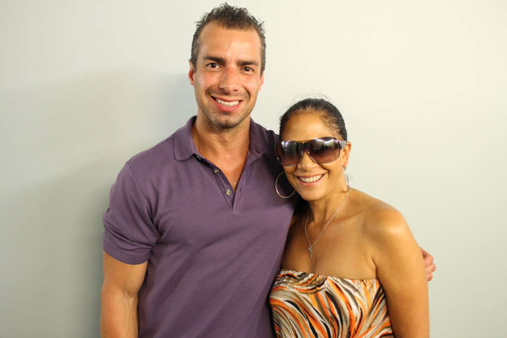 Take Two host A Martinez poses with musician Sheila E after their interview at KPCC.