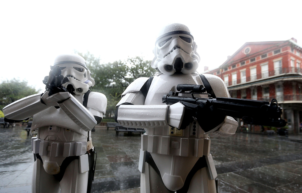 A pair of Stormtroopers walk through Jackson Square in New Orleans's French Quarter as heavy rain from Hurricane Nate begin comes down on Saturday, October 7, 2017.