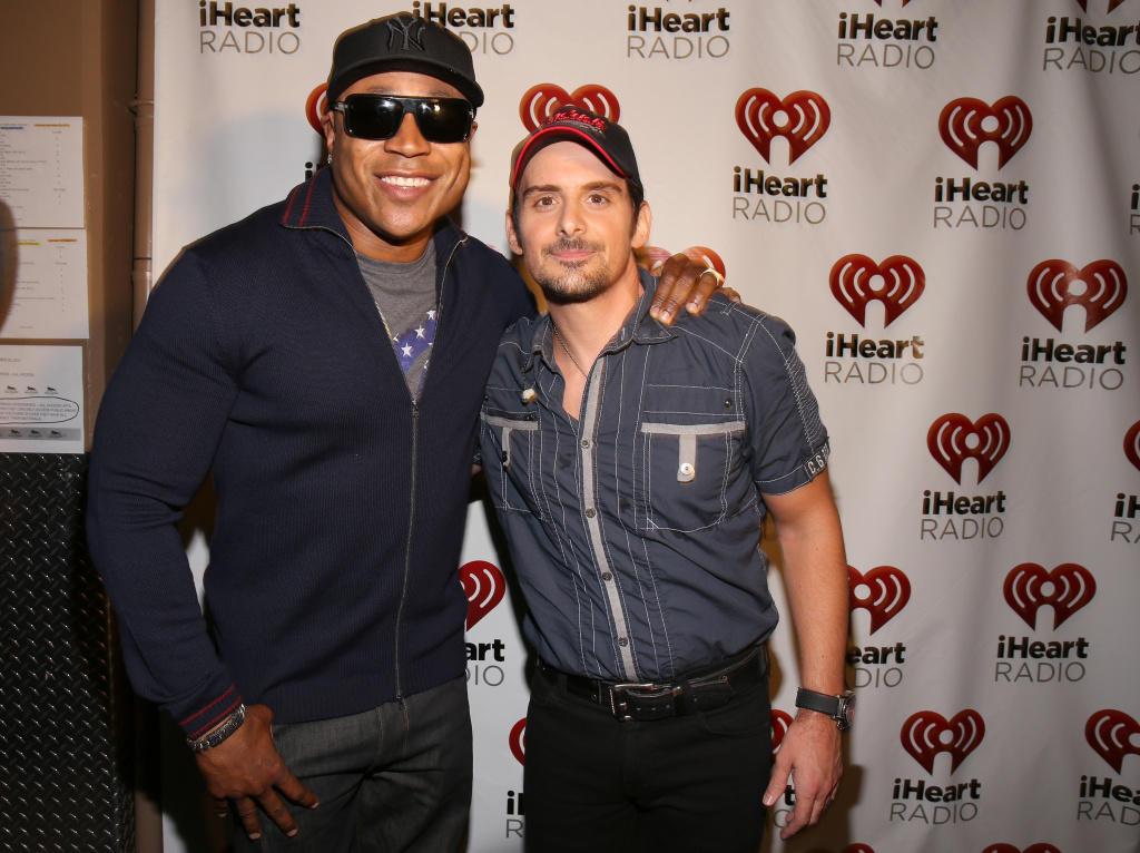Actor/rapper LL Cool J (L) and recording artist Brad Paisley appear backstage during the 2012 iHeartRadio Music Festival.